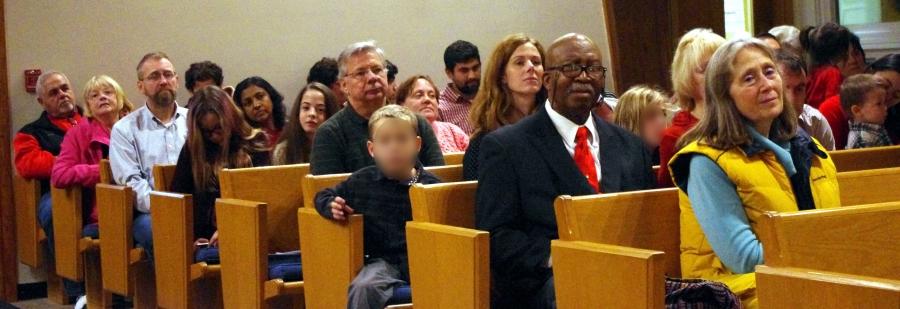 People sitting in pews in worship