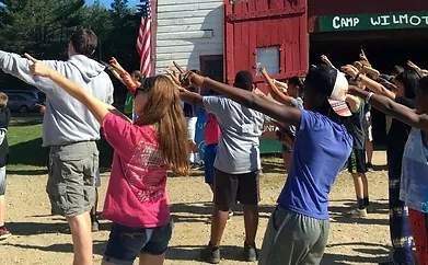 Young campers dancing at Camp Wilmot