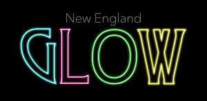 """New England GLOW"" in neon letters"