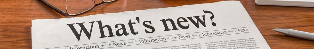 "Image of a paper lying on a desktop with the headline ""What's New?"""