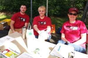 Staff and volunteers distributing weekly CSA food share outside the church.