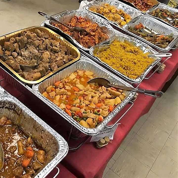 Trays of food on serving table
