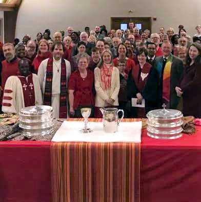 Full sanctuary, table set for communion
