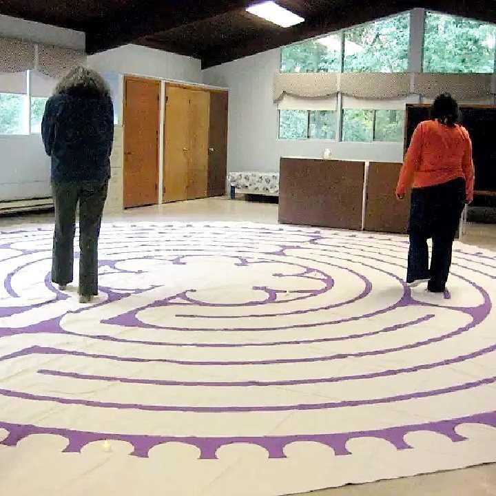 Women walking labyrinth in fellowship hall